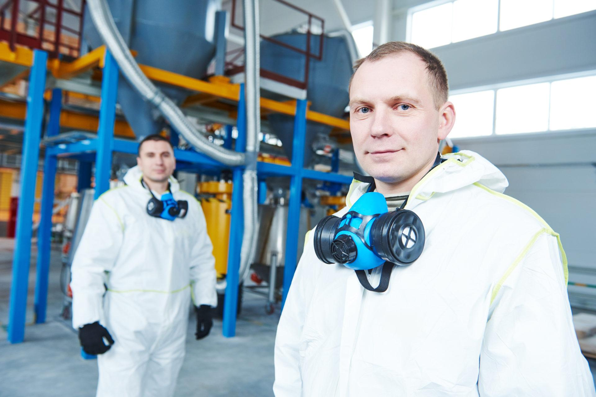two chemical industry workers at industrial factory